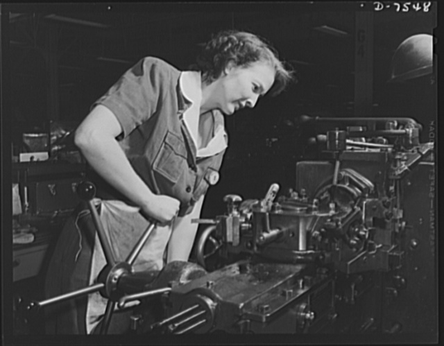 "Production. Airplane manufacture, general. This woman employee operates a turret lathe in the machine shop at the Inglewood, California, plant of North American Aviation, Incorporated. She handles the machine as skillfully as a man. This plant produces the battle-tested (""Billy Mitchell"") bomber, used in General Doolittle's raid on Tokyo, and the P-51 (""Mustang"") fighter plane, which was first brought into prominence by the British raid on Dieppe"