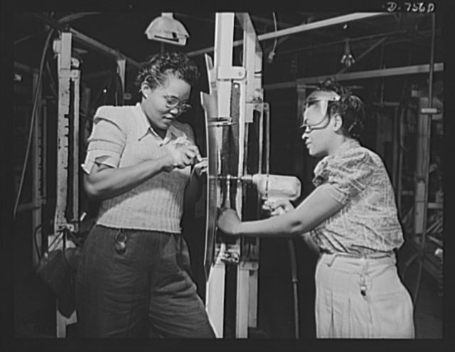 "Production. Airplane manufacture, general. Two Negro women employees in North American Aviation's wing sub-assembly department at Inglewood, California, drill and rivet wing sections for fighter and bomber planes. This plant produces the battle-tested B-25 (""Billy Mitchell"") bomber, used in General Doolittle's raid on Tokyo, and the P-51 (""Mustang"") fighter plane, which was first brought into prominence by the British raid on Dieppe"