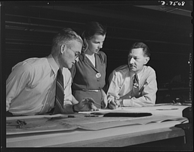 "Production. Airplane manufacture, general. Two skilled engineers discuss a drawing of a plane part with a woman employee in the drafting department of the Inglewood, California, plant of North American Aviation, Incorporated. This plant produces the battle-tested B-25 (""Billy Mitchell"") bomber, used in General Doolittle's raid on Tokyo, and the P-51 (""Mustang"") fighter plane, which was first brought into prominence by the British raid on Dieppe"