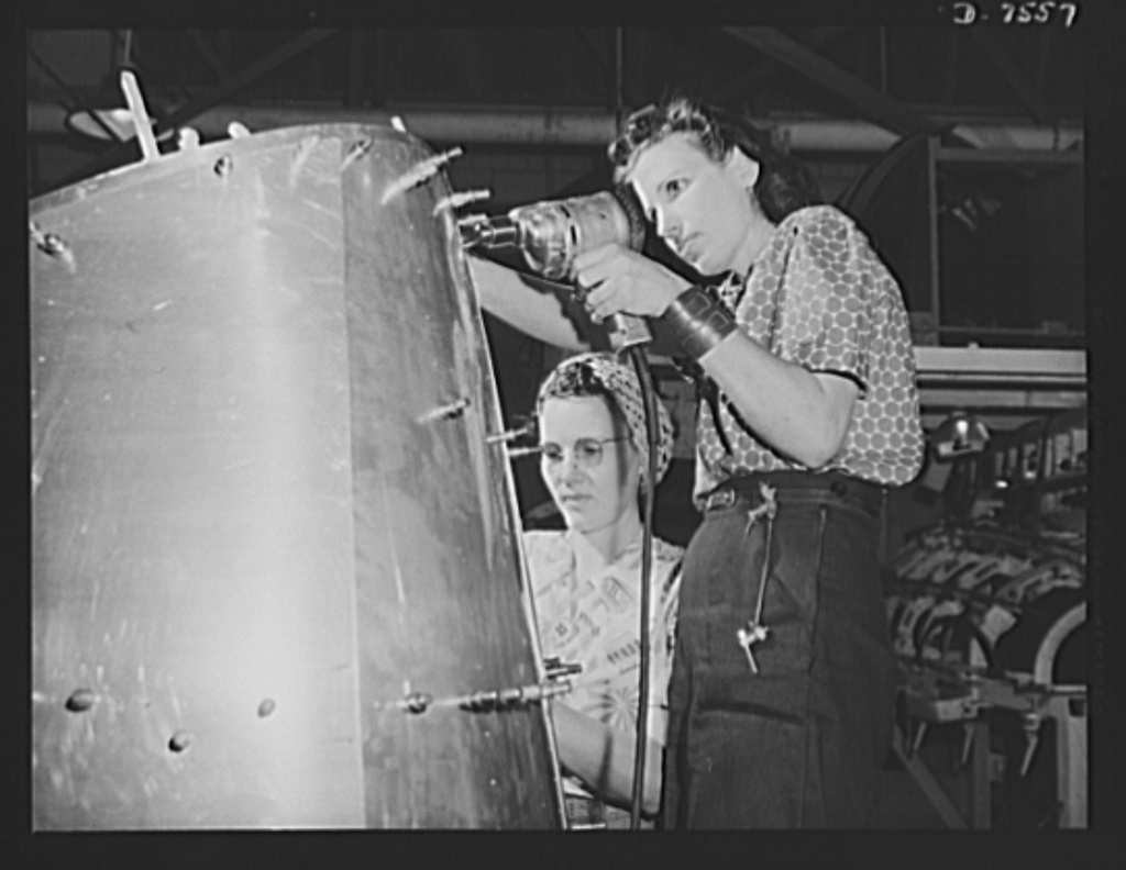 "Production. Airplane manufacture, general. Two woman worker at the Inglewood, California, plant of North American Aviation, Incorporated, prepare a B-25 nacelle for riveting. This plant produces the battle-tested B-25 (""Billy Mitchell"") bomber, used in General Doolittle's raid on Tokyo, and the P-51 (""Mustang"") fighter plane, which was first brought into prominence by the British raid on Dieppe"