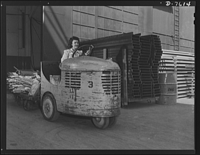 "Production. Airplane manufacture, general. Women operate plant tractors that pull trailer loads of supplies and parts through the Inglewood, California, shops of North American Aviation. This plant produces the battle-tested B-25 (""Billy Mitchell"") bomber, used in General Doolittle's raid on Tokyo, and the P-51 (""Mustang"") fighter plane, which was first brought into prominence by the British raid on Dieppe"