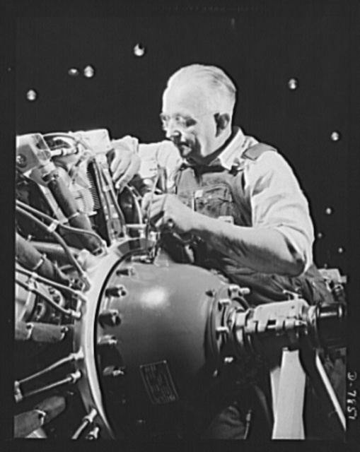 "Production. Airplane maufacture, general. A seasoned mechanic at the Long Beach, California, Douglas Aircraft Company, makes final adjustments on an engine for a new airplane. Most important of the many types of aircraft made at this plant are the B-17F (""Flying Fortress"") heavy bomber, the A-20 (""Havoc"") assault bomber and the C-47 heavy transport plane for the carrying of troops and cargo"