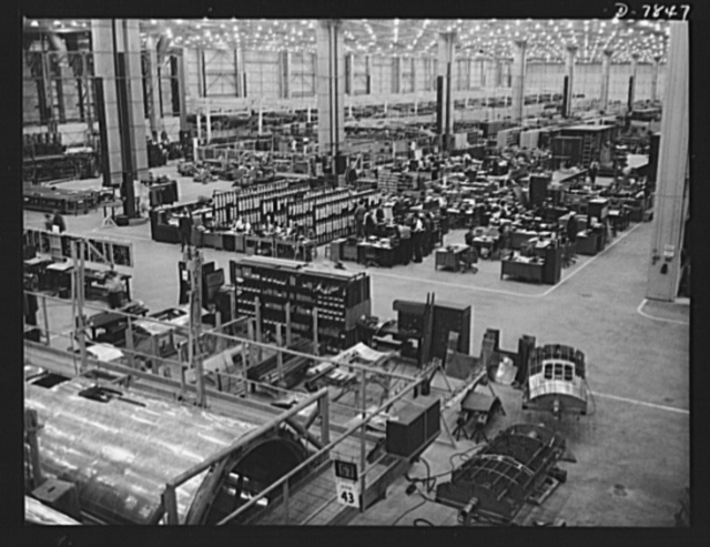 "Production. Airplane maufacture, general. Clerical jobs along the assembly line at Douglas Aircraft Company's Long Beach, California, plant are as necessary as the mechanical jobs in producing finished warplanes. Most important of the many types of aircraft made at this plant are the B-17F (""Flying Fortress"") heavy bomber, the A-20 (""Havoc"") assault bomber and the C-47 heavy transport plane for the carrying of troops and cargo"
