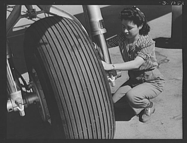 "Production. Airplane maufacture, general. Conservation of civilian tires makes possible this airplane tire ready to leave the Long Beach, California, plant of Douglas Aircraft Company. Most important of the many types of aircraft made at this plant are the B-17F (""Flying Fortress"") heavy bomber, the A-20 (""Havoc"") assault bomber and the C-47 heavy transport plane for the carrying of troops and cargo"