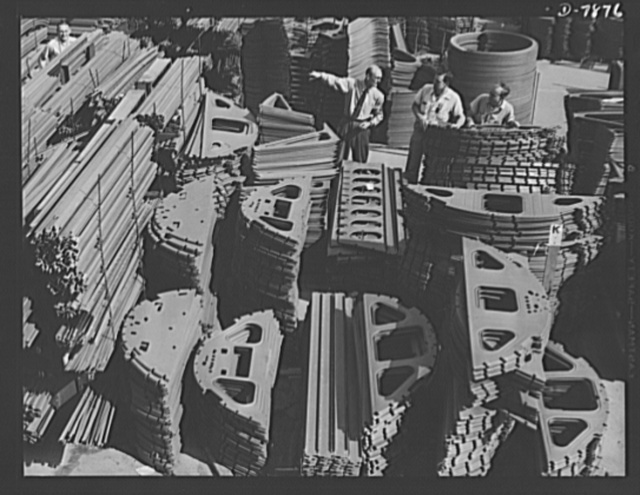 "Production. Airplane maufacture, general. Prefabricated plane parts await installation on the assembly lines at the Long Beach, California, plant of Douglas Aircraft Company. Most important of the many types of aircraft made at this plant are the B-17F (""Flying Fortress"") heavy bomber, the A-20 (""Havoc"") assault bomber and the C-47 heavy transport plane for the carrying of troops and cargo"