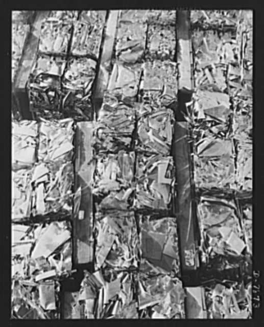 "Production. Airplane maufacture, general. Sheet metal scrap is carefully held and segregated for maximun salvage value at the Long Beach, California, plant of Douglas Aircraft Company. Most important of the many types of aircraft made at this plant are the B-17F (""Flying Fortress"") heavy bomber, the A-20 (""Havoc"") assault bomber and the C-47 heavy transport plane for the carrying of troops and cargo"