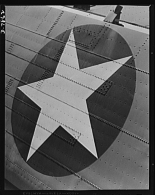 "Production. Airplane maufacture, general. The symbol of democracy, newly painted on a heavy bomber at the Long Beach, California, plant of Douglas Aircraft Company, brings hope to enslaved people in Axis-dominated lands. Most important are the many types of aircraft made at this plant are the B-17F (""Flying Fortress"") heavy bomber, the A-20 (""Havoc"") assault bomber and the C-47 heavy transport plane for the carrying of troops and cargo"