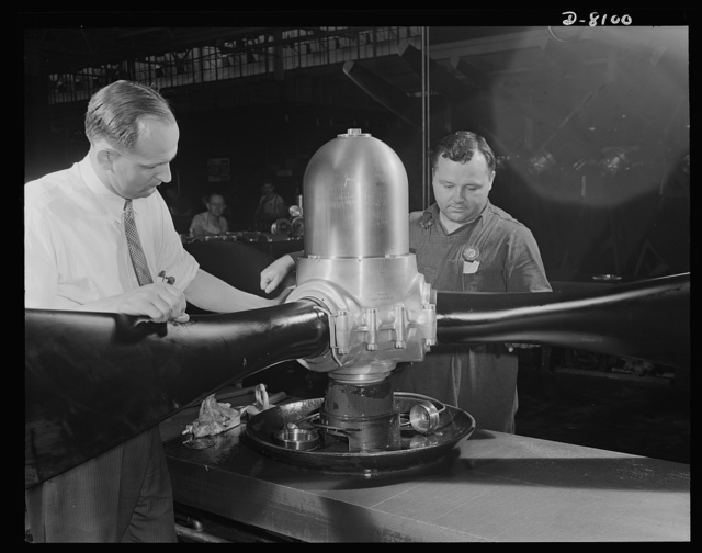 Production. Airplane propellers. A three-bladed hydromatic propeller assembly for an American warplane is tested for oil leakage at a Hartford, Connecticut, plant. With this propeller, adjustments of blade pitch are made while the plane is in action