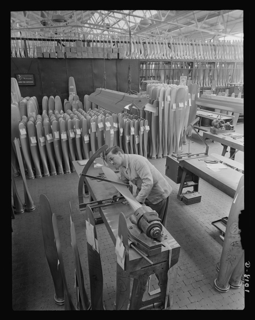 Production. Airplane propellers. Arthur Voss checks angles and makes final dimensional inspections of a propeller blade for an American warplane at the Hartford, Connecticut, plant. This blade will later be mounted with others in a hydromatic mechanism that will permit adjustment of pitch while planes are in action