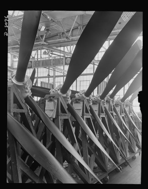 Production. Airplane propellers. Assembled three-way Hamilton propellers  ready for shipment, minus power section, from a Hartford, Connecticut, plant. When installed on a warplane, this type of propeller will be fitted with a hydromatic mechanism that varies the blade pitch during flight