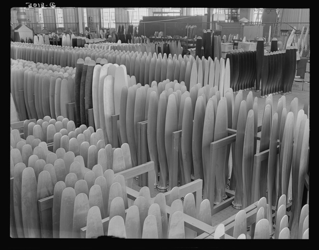 Production. Airplane propellers. Finished propeller blades ready for assembly at a Hartford, Connecticut, plant. These blades will later be mounted in combinations of two, three and four in hydromatic mechanisms that permit adjustments of blade pitch while planes are in action