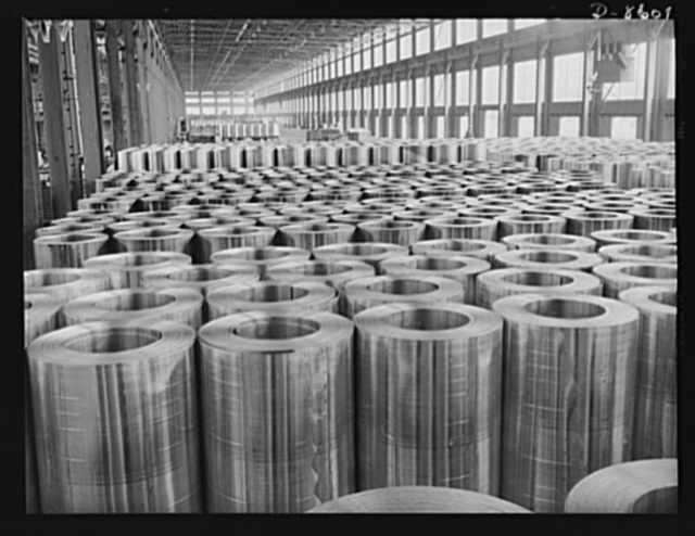 Production. Aluminum. Hundreds of coils of aluminum sheet stock assembled on the cooling floor prior to cold-rolling, the final thinning operation