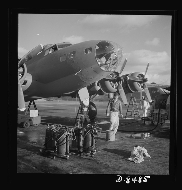 Production. B-17 heavy bomber. Lubricating and servicing a new B-17F (Flying Fortress) bomber for flight tests at the airfield of Boeing's Seattle plant. Ships are delivered to the Army and the Navy after they have successfully undergone flight tests. The Flying Fortress has performed with great credit in the South Pacific, over Germany and elsewhere. It is a four-engine heavy bomber capable of flying at high altitudes