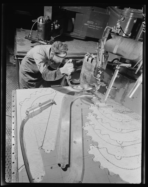 Production. B-17 heavy bomber. Parts for a new B-17F (Flying Fortress) bomber are cut on a routing machine in the Boeing plant in Seattle. The Flying Fortress, a four-engine heavy bomber capable of flying high altitudes, has performed with great credit in the South Pacific, over Germany and elsewhere. It is a four-engine heavy bomber capable of flying at high altitudes