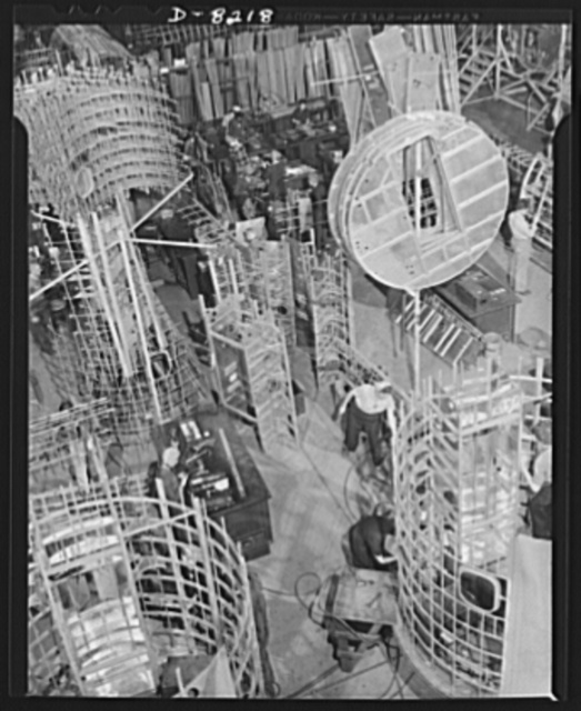 Production. B-17 heavy bomber. Sections of framework for a B-17F (Flying Fortress) bomber fuselages at the Boeing plant in Seattle. The Flying Fortress, has performed with great credit in the South Pacific, over Germany and elsewhere. It is a four-engine heavy bomber capable of flying at high altitudes