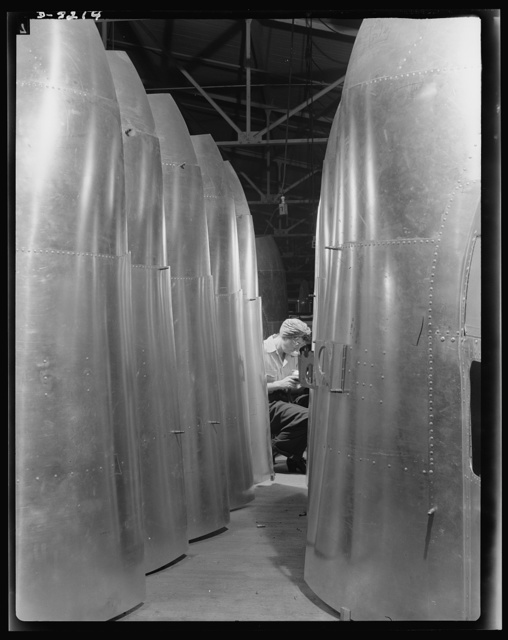 Production. B-17 heavy bomber. Tail parts for B-17F (Flying Fortress) bombers ready for assembly into the big warships of air at the Boeing plant in Seattle. Rear turrets will be fitted to these parts. The Flying Fortress has performed with great credit in the South Pacific, over Germany and elsewhere. It is a four-engine heavy bomber capable of flying at high altitudes