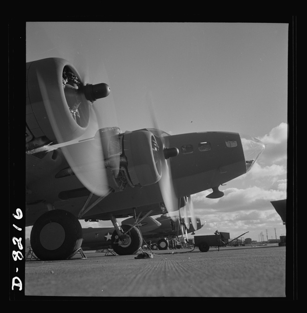 Production. B-17 heavy bomber. Two of the four mighty engines of a new B-17F (Flying Fortress) bombers warm up at the airfield of Boeing's Seattle plant as another warship of the air awaits its flight test. The Flying Fortress has performed with great credit in the South Pacific, over Germany and elsewhere. It is a four-engine heavy bomber capable of flying at high altitudes