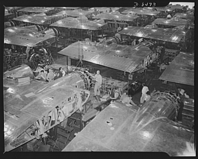 Production. B-17 heavy bomber. Wing section, each containing two powerful Wright engines await mating the fuselage sections of new B-17F (Flying Fortress) bomber. The Flying Fortress has performed with great credit in the South Pacific, over Germany and elsewhere. It is a four-engine heavy bomber capable of flying at high altitudes