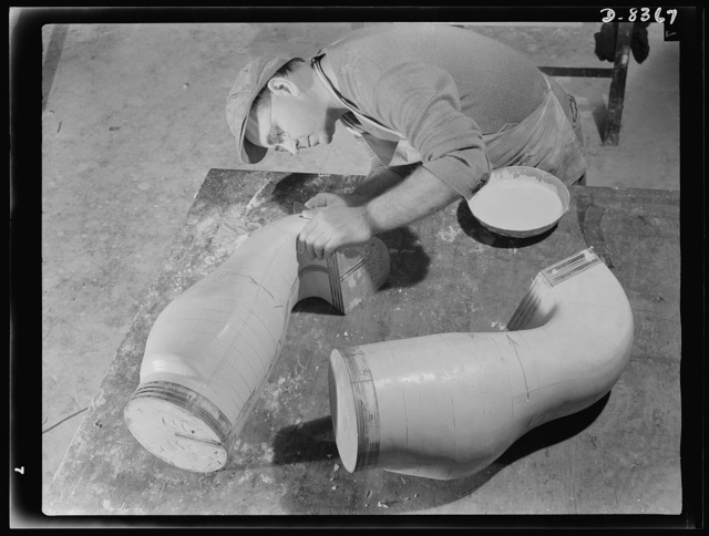 Production. B-17F heavy bomber. E. Waters finishes plaster casts of ducts for B-17F (Flying Fortress) bombers at the Boeing plant at Seattle. The patterns will be reproduced on a Kellar machine. The Flying Fortress, a four-engine heavy bomber capable of flying at high altitudes, has performed with great credit in the South Pacific, over Germany and elsewhere