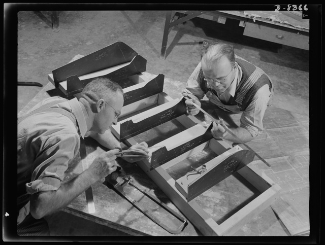 Production. B-17F heavy bomber. G.H. Knight and A. Johnson prepare the base for a plastic pattern of parts for B-17F (Flying Fortress) bombers at the Boeing plant at Seattle. The patterns will be reproduced on a Kellar machine. The Flying Fortress, a four-engine heavy bomber capable of flying at high altitudes, has performed with great credit in the South Pacific, over Germany and elsewhere
