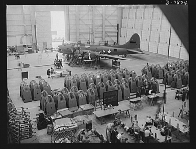 "Production. B-17F heavy bombers. A completed B-17F heavy bomber is checked by final inspectors at the Long Beach, California, plant of Douglas Aircraft Company, before it moves to the flight line for rigid acceptance tests. Better known as the ""Flying Fortress,"" the B-17F is a later model of the B-17, which distinguished itself in action in the South Pacific, over Germany and elsewhere. It is a long range, high altitude, heavy bomber with a crew of seven to nine men and with armament sufficient to defend itself on daylight missions"