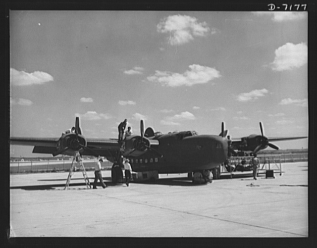 Production. B-24 bombers and C-87 transports. Another masterpiece of American mass production. A new consolidated transport, just off the assembly line of a Western aircraft plant, gets a final checkup preparatory to a test flight. This new transport, an adaptation of the B-24 bomber, is known as the C-87 and carries one of the greatest human or cargo loads of any plane now in mass production. It is built in a plant equipped with one of the best and most modern air conditioning and fluorescent lighting systems in the country
