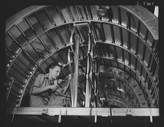 Production. B-24 bombers and C-87 transports. Cabbie Coleman, former housewife, works in a Western aircraft plant installing oxygen flask racks above the flight deck of a consolidated transport. This ship, adapted from the B-24 bomber, is known as the C-87, and carries one of the greatest human or cargo loads of any plane now in mass production.