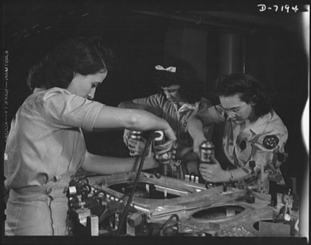 Production. B-24 bombers and C-87 transports. Drilling a wing bulkhead for a consolidated transport plane, that will carry American soldiers and equipment to our far-flung battle lines. One of these girls was a worker in a potato products factory, one was a laundering demonstrator and one is holding her first job. The plane they are helping to make will carry one of the greatest human or cargo loads of any plane now in mass production.