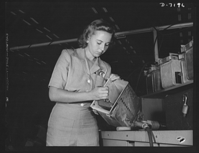 Production. B-24 bombers and C-87 transports. Geneva Grishan installs a part on an ammunition box for a new consolidated transport plane. Before she went into war work at a western war plant she attended radio school. The plane she helps to make will carry one of the greatest human or cargo loads of any plane now in mass production. It has the greatest speed of any American bomber except its consolidated B-24 counterpart