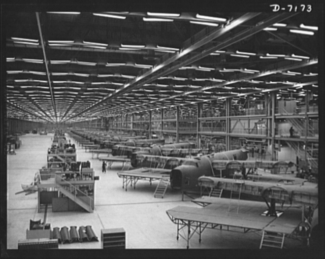 Production. B-24 bombers and C-87 transports. Half down the final line of a Western aircraft plant at which consolidated B-24 bombers and transports are made. This new transports, an adaptation of the B-24 bomber, is known as the C-87 and carries one of the greatest human or cargo loads of any plane now in mass production. It is built in a plant equipped with one of the best air conditioning and fluorescent lighting systems in the country