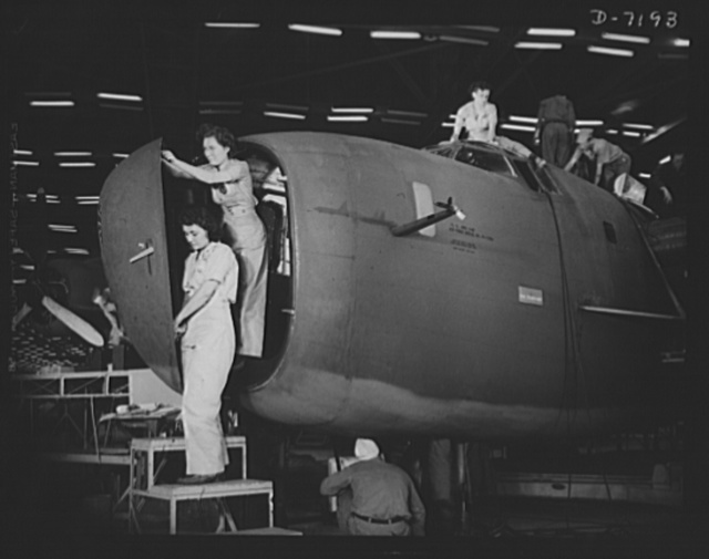 Production. B-24 bombers and C-87 transports. Installing the nose door of a consolidated transport plane, one of the last assembly line operations at a Western aircraft plant. Here womanpower and manpower work together or various sections of the plane. This new transport, an adaptation of the B-24 greatest human or cargo loads of any plane now in mass production. It is built in a plant equipped with one of the best and most modern air conditioning and fluorescent lighting systems in the country