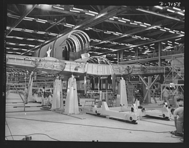 Production. B-24 bombers and C-87 transports. The tail of a consolidated transport plane is fitted to the wing center section in the fuselage mating fixture at a Western aircraft plant. This new transport, an adaptation of the B-24 bomber, is known as the C-87, and carries one of the greatest human or cargo loads of any plane now in mass production. It is built in a plant equipped with the best and most modern air conditioning and fluorescent lighting systems in the country
