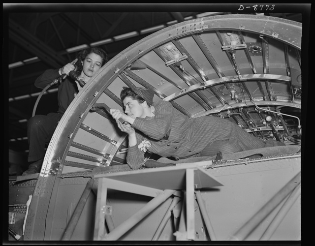 Production. B-24E (Liberator) bombers at Willow Run. A girl team working on a center wing section of a B-24E (Liberator) bomber in Ford's big Willow Run plant. The Liberator is capable of operation at high altitudes and over great ranges on precision bombing missions. It has proved itself an excellent performer in the Pacific, in Northern Africa, Europe and the Aleutians. Ford's Willow Run Plant, Michigan