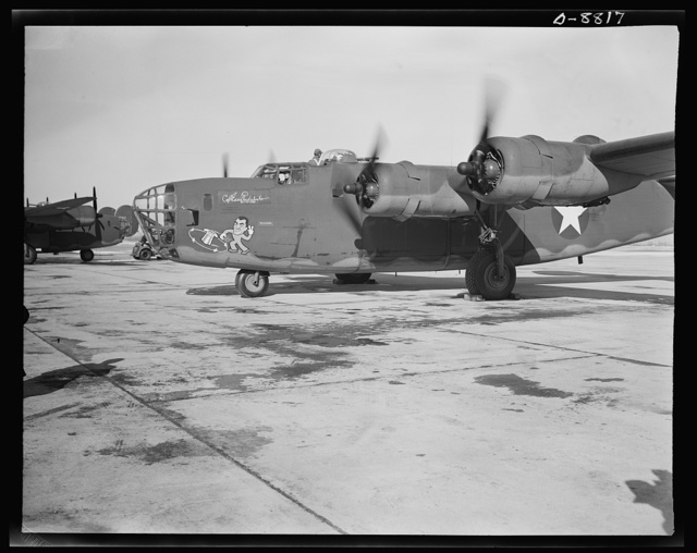 Production. B-24E (Liberator) bombers at Willow Run. A new B-24E (Liberator) bomber, named for Captain Eddie Rickenbacker and bearing his autograph returns to the airfield at Ford's big Willow Run plant after a successful trial flight. The Liberator is capable of operation at altitudes and over great ranges on precision bombing missions. It has proved itself an excellent performer in the Pacific, in Northern Africa, Europe and the Aleutians. Ford's Willow Run Plant, Michigan