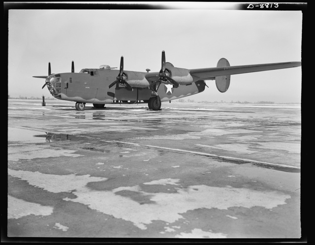 Production. B-24E (Liberator) bombers at Willow Run. A new B-24E (Liberator) bomber, just off the assembly line at Ford's big Willow Run plant, gets a last-minute inspection before taking off on its test flights. The Liberator is capable of operation at high altitudes and over great ranges on precision bombing missions. It has proved itself an excellent performer in the Pacific, in Northern Africa, Europe and the Aleutians. Ford's Willow Run Plant, Michigan