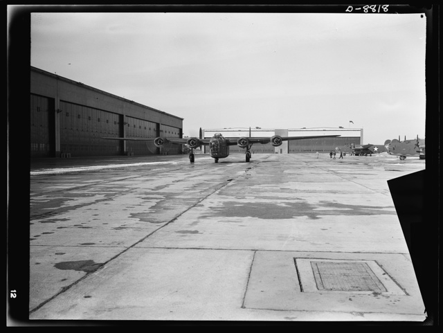 Production. B-24E (Liberator) bombers at Willow Run. A new B-24E (Liberator) bomber just returned from a successful trial flight taxis down a runway at Ford's big Willow Run plant. The Liberator is capable of operation at high altitudes and over great ranges on precision bombing missions. It has proved itself an excellent performer in the Pacific, in Northern Africa, Europe and the Aleutians. Ford's Willow Run Plant, Michigan