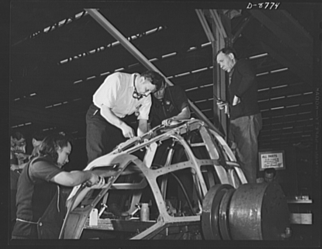 Production. B-24E (Liberator) bombers at Willow Run. Assembling the frame of a nose for a B-24E (Liberator) bomber in Ford's big Willow Run plant. The Liberator is capable of operation at high altitudes and over great ranges on precision bombing missions. It has proved itself an excellent performer in the Pacific, in Northern Africa, Europe and the Aleutians. Ford's Willow Run Plant, Michigan