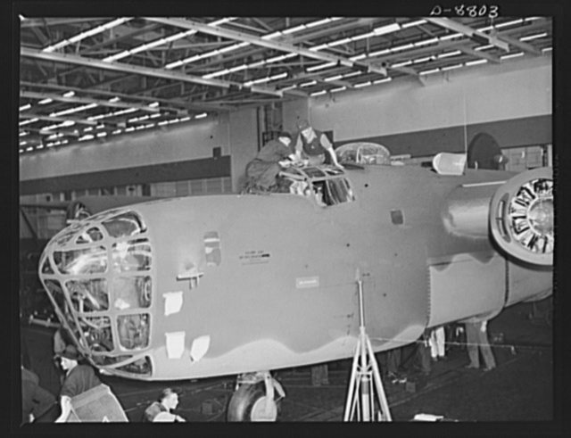 Production. B-24E (Liberator) bombers at Willow Run. Final touch-ups and inspections are made on a new B-24E (Liberator) bomber after it has received a paint job at Ford's big Willow Run plant. The Liberator is capable of operation at high altitudes and over great ranges on precision bombing missions. It has proved itself an excellent performer in the Pacific, in Northern Africa, Europe and the Aleutians. Ford's Willow Run Plant, Michigan