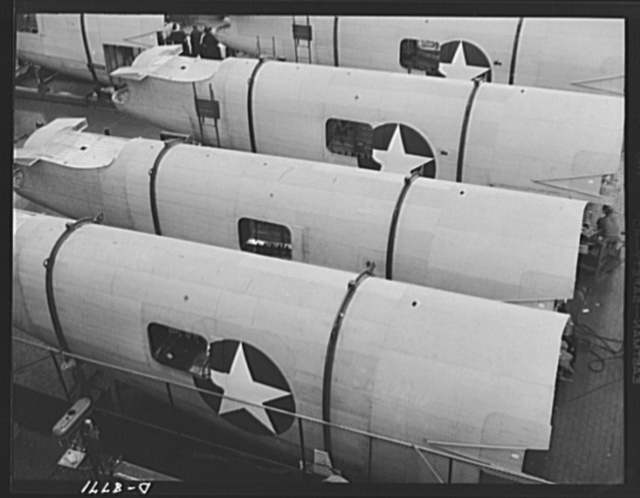 Production. B-24E (Liberator) bombers at Willow Run. Fuselage sections for B-24E (Liberator) bombers being completed before going to one of the two final assembly lines of Ford's big Willow Run plant. The Liberator is capable of operation at high altitudes and over great ranges on precision bombing missions. It has proved itself an excellent performer in the Pacific, in Northern Africa, Europe and the Aleutians. Ford's Willow Run Plant, Michigan