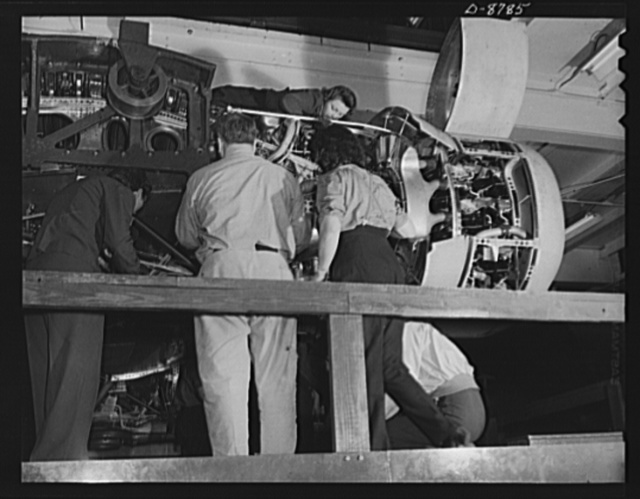 Production. B-24E (Liberator) bombers at Willow Run. Installing one of the four engines of a new B-24E (Liberator) bomber on one of the assembly lines of Ford's big Willow Run plant. The Liberator is capable of operation at high altitudes and over great ranges on precision bombing missions. It has proved itself an excellent performer in the Pacific, in Northern Africa, Europe and the Aleutians. Ford's Willow Run Plant, Michigan