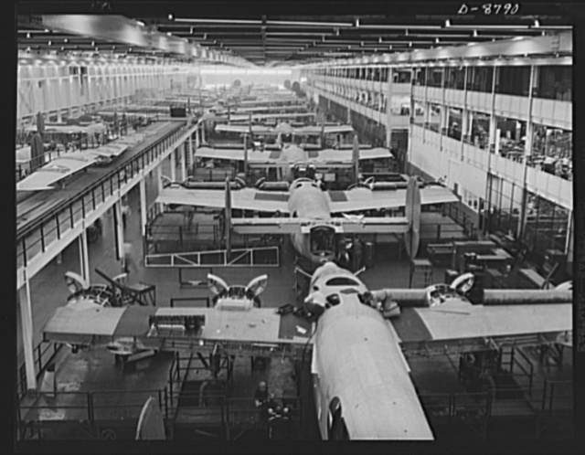 Production. B-24E (Liberator) bombers at Willow Run. Looking down one of the two final assembly lines for B-24E (Liberator) bombers at Ford's big Willow Run plant. Guns and wing tips have not yet been added to the planes in the foreground. The Liberator is capable of operation at high altitudes and over great ranges on precision bombing missions. It has proved itself an excellent performer in the Pacific, in Northern Africa, Europe and the Aleutians. Ford's Willow Run Plant, Michigan