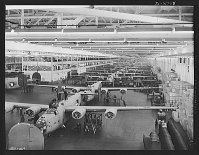Production. B-24E (Liberator) bombers at Willow Run. Looking up one of the assembly lines at Ford's big Willow Run plant, where B-24E (Liberator) bombers are being made in great numbers. The Liberator is capable of operation at high altitudes and over great ranges on precision bombing missions. It has proved itself an excellent performer in the Pacific, in Northern Africa, Europe and the Aleutians. Ford's Willow Run Plant, Michigan