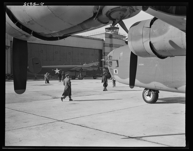 Production. B-24E (Liberator) bombers at Willow Run. New B-24E (Liberator) bombers just completed at Ford's big Willow Run plant, have been rolled from the hangars for test flights. The Liberator is capable of operation at high altitudes and over great ranges on precision bombing missions. It has proved itself an excellent performer in the Pacific, in Northern Africa, Europe and the Aleutians. Ford's Willow Run Plant, Michigan
