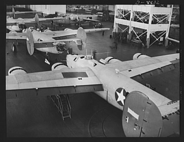 Production. B-24E (Liberator) bombers at Willow Run. New Liberator (B-24E) bombers await paint jobs after coming off the assembly lines at Ford's big Willow Run plant. The Liberator is capable of operation at high altitudes and over great ranges on precision bombing missions. It has proved itself an excellent performer in the Pacific, in Northern Africa, Europe and the Aleutians. Ford's Willow Run Plant, Michigan