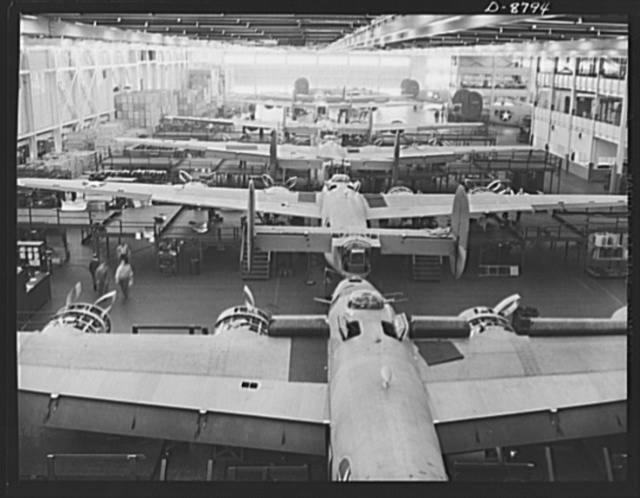 Production. B-24E (Liberator) bombers at Willow Run. New Liberator (B-24E) bombers, nearly completed and ready to roll off one of the assembly lines at Ford's big Willow Run plant. The Liberator is capable of operation at high altitudes and over great ranges on precision bombing missions. It has proved itself an excellent performer in the Pacific, in Northern Africa, Europe and the Aleutians. Ford's Willow Run Plant, Michigan