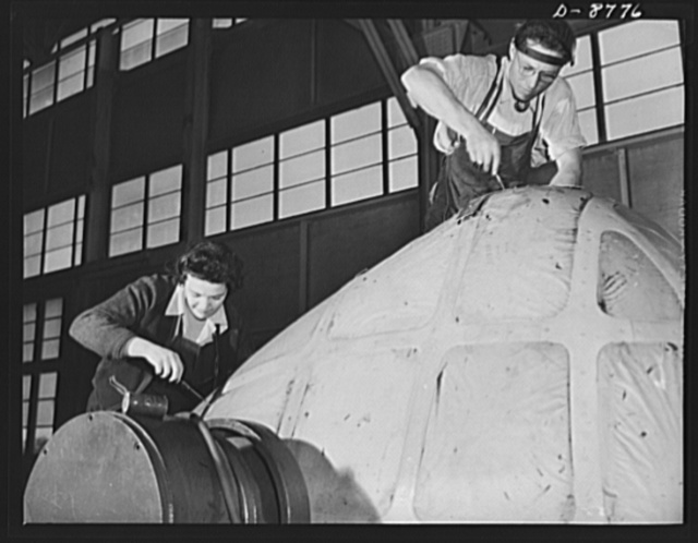 Production. B-24E (Liberator) bombers at Willow Run. Setting lights of transparent plastic in the nose for a B-24E (Liberator) bomber in Ford's big Willow Run plant. The Liberator is capable of operation at high altitudes and over great ranges on precision bombing missions. It has proved itself an excellent performer in the Pacific, in Northern Africa, Europe and the Aleutians. Ford's Willow Run Plant, Michigan