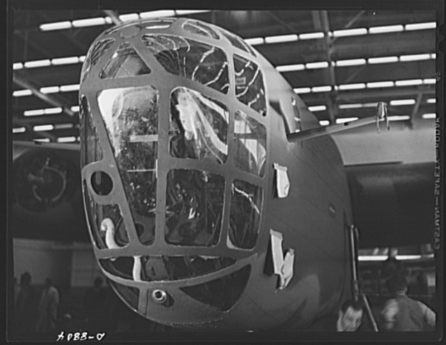 Production. B-24E (Liberator) bombers at Willow Run. The nose of a new B-24E (Liberator) bomber, just off the assembly line and paint shop at Ford's big Willow Run plant, and now ready for its test flights. The Liberator is capable of operation at high altitudes and over great ranges on precision bombing missions. It has proved itself an excellent performer in the Pacific, in Northern Africa, Europe and the Aleutians. Ford's Willow Run Plant, Michigan