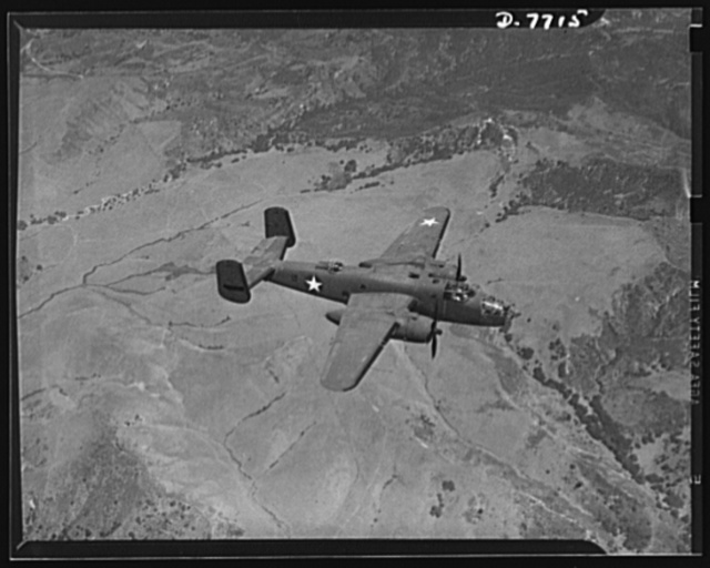 """Production. B-25 """"Billy Mitchell"""" bombers. A North American B-25 medium bomber in the service of the U.S. Army flies over the Inglewood, California, plant in which it was built. In addition to the battle-tested B-25 """"Billy Mitchell"""" bomber, used in General Doolittle's raid on Tokyo, this plant produces the P-51 """"Mustang"""" fighter plane which was first brought into prominence by the British raid on Dieppe"""