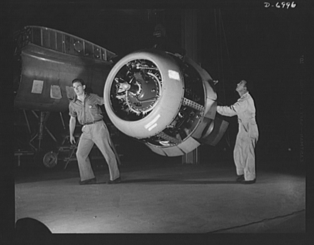 Production. B-25 bombers. A Wright Whirlwind engine ready for installation in a new B-25 medium bomber in a Western aircraft plant. The B-25 is driven by two of these 1700-horsepower engines which perform brilliantly at the plane's ceiling of 25,000 feet. Fairfax bomber plant, Kansas City