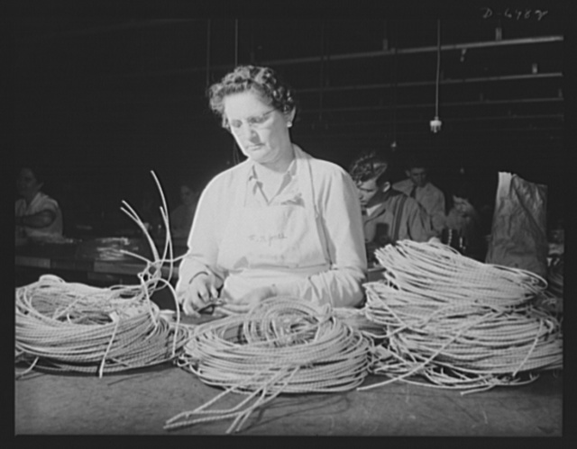 Production. B-25 bombers. Ignition wiring for B-25 (Billy Mitchell) bombers is prepared for use by a woman worker in a large Western aircraft plant. Many women are employed in this plant at jobs that once were considered exclusively men's work. Fairfax bomber plant, Kansas City